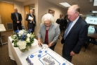 Merryll Penson and Chancellor Hank Huckaby Cut GALILEO's 20th Birthday Cake
